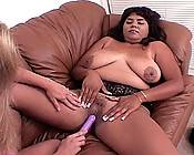 Black bitch having her fat cunt rammed by a dildo.