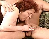 Mature redhead mouth pumping a huge cock in a hot threesome