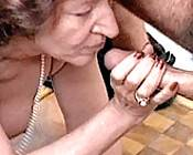Blonde granny servicing three studs while horny redhead sucks cock