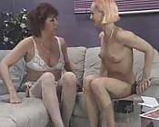 Redhead grandma in lesbian play getting kinky with young blonde babe