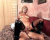 Experienced blonde getting a hard banging with her black stockings on.