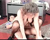 Granny secretary keeping her client occupied with a hot blowjob